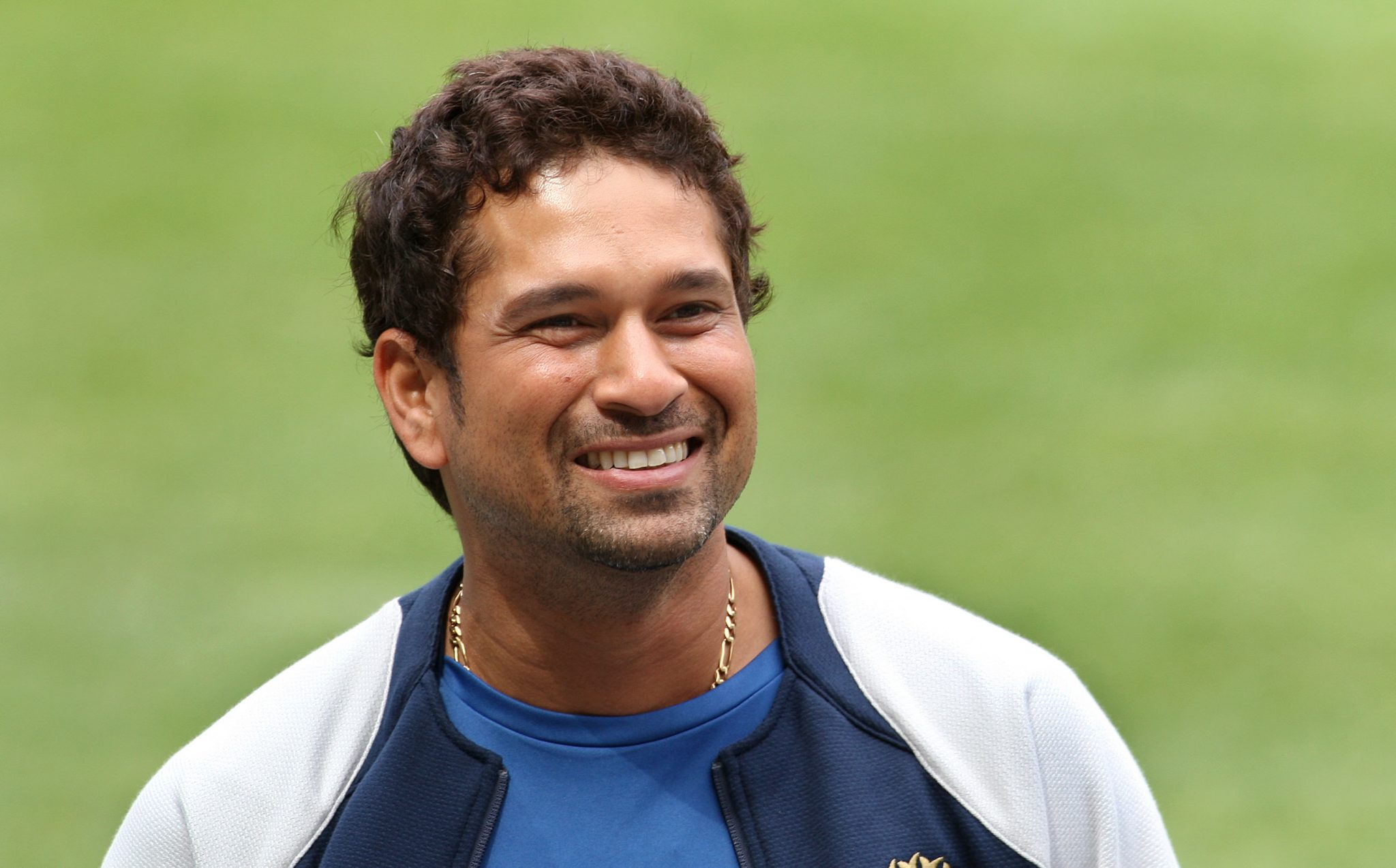 Indian players Sachin Tendulkar smiles after inspecting the wicket