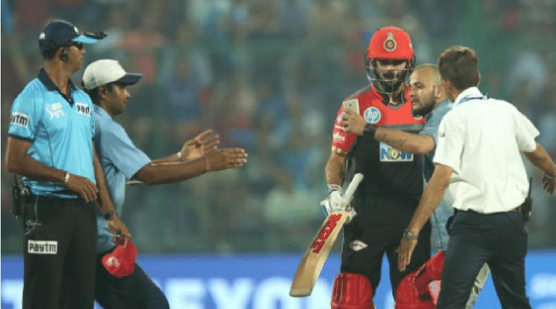 Fan runs on to the field, clicks selfie with Kohli