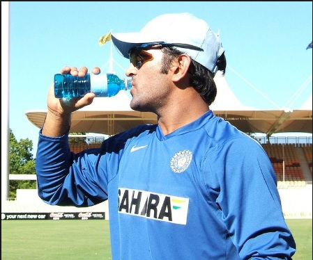 MS Dhoni and Shoaib Malik greet each other during practice