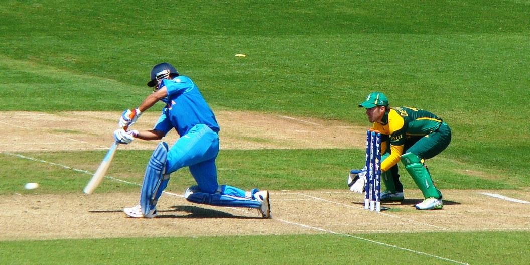 MS Dhoni hits a six down the ground