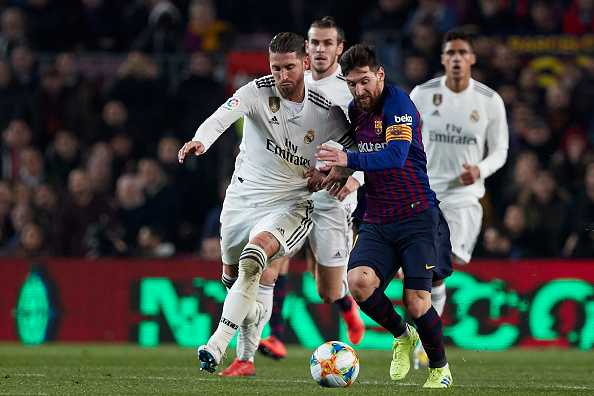 Sergio Ramos and Lionel Messi battle out for the ball