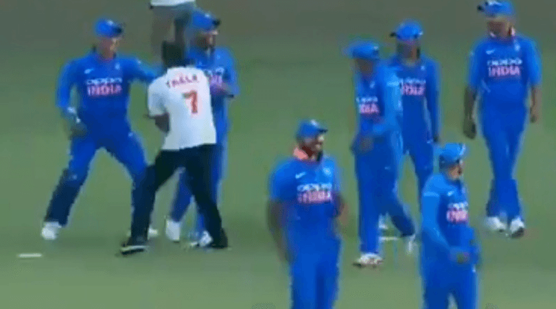 MS Dhoni chased around by an invader