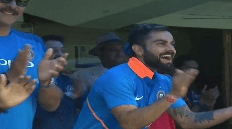 Virat Kohli celebrates as Jasprit Bumrah hits a six