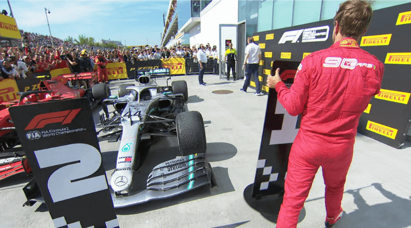 Sebastian Vettel puts the number 2 board in front of Lewis Hamilton's car after Canadian GP controversy