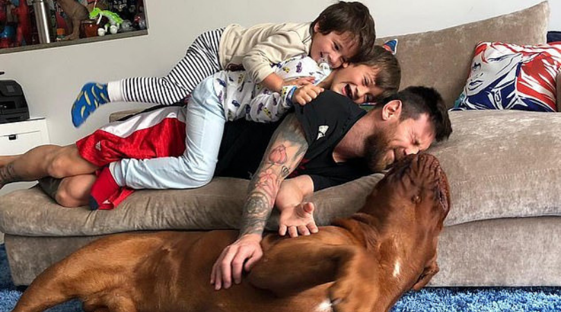 Lionel Messi: Watch Barcelona Superstar play piggy in the middle with his dog Hulk and children Thiago and Mateo