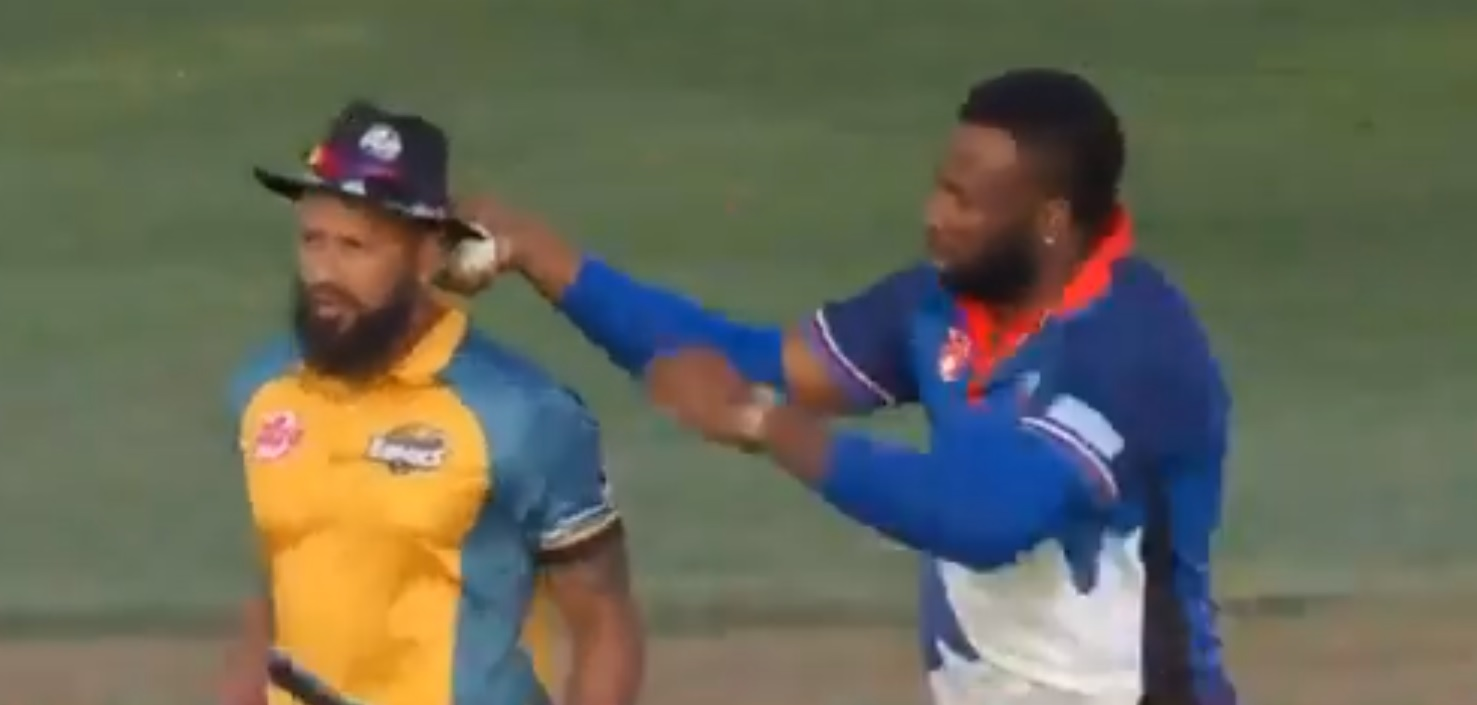 Watch: Kieran Pollard puts umpire's hat on Rayad Emrit's head for arguing with the officials