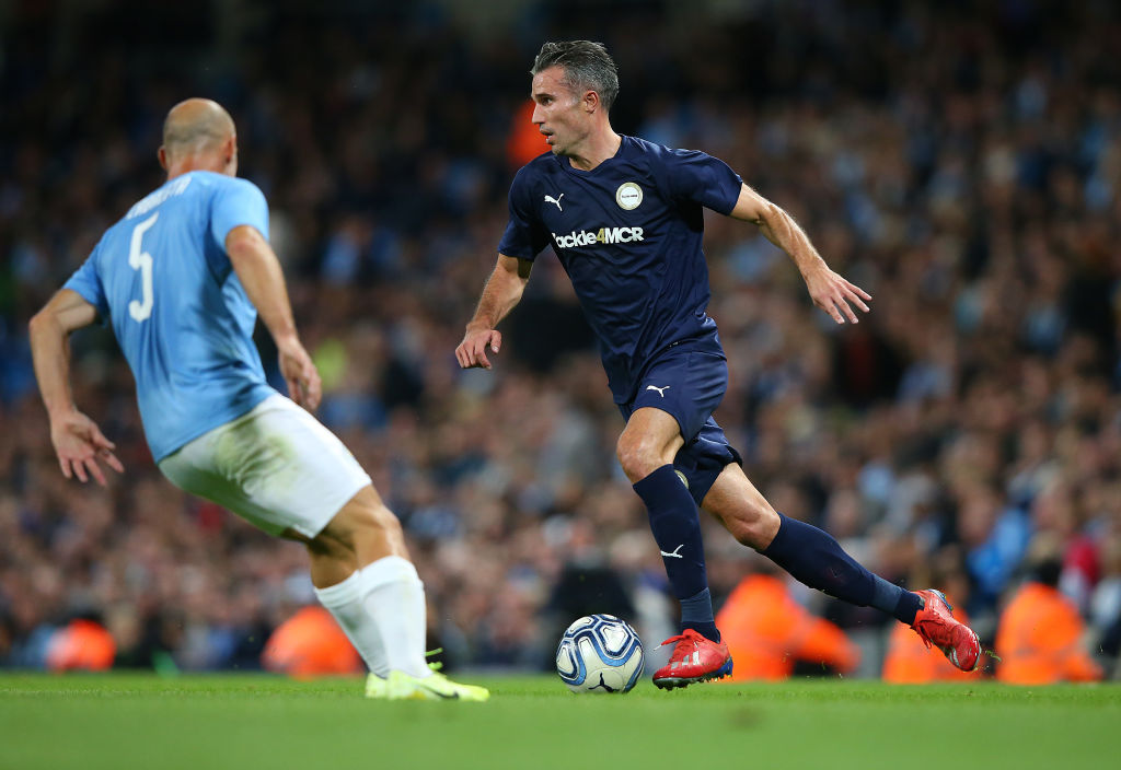 Van Persie wore Manchester United shin pads as he starred with an assist and a goal in Kompany's testimonial last night