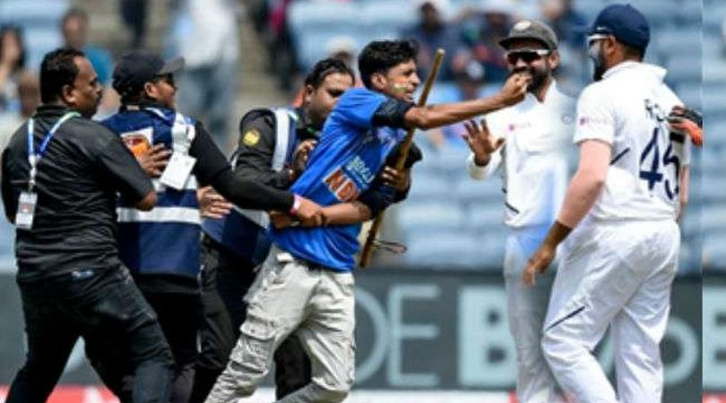 Rohit Sharma falls down after fan tries to touch his feet after invading into pitch