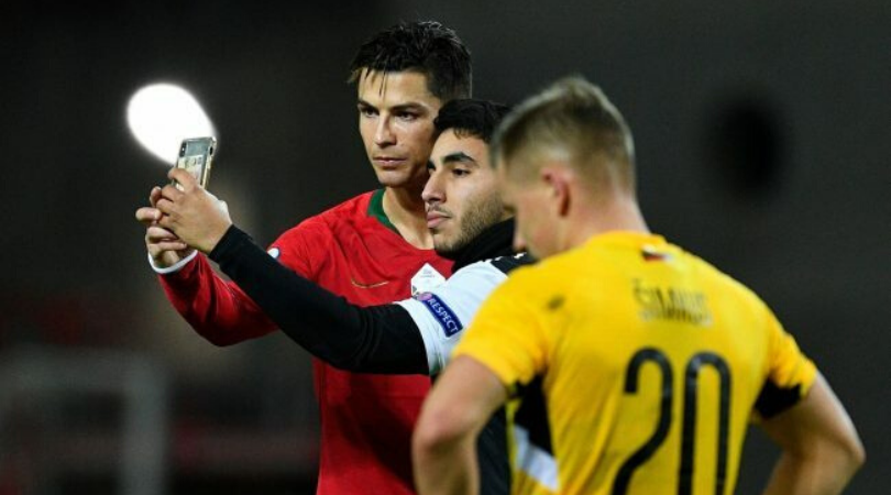 Cristiano Ronaldo stops match to take selfie with pitch invader during Portugal vs Lithuania