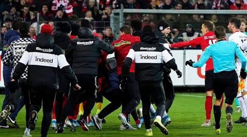 Eintracht Frankfurt captain David Abraham attacks Freiburg manager with WWE-style clothesline