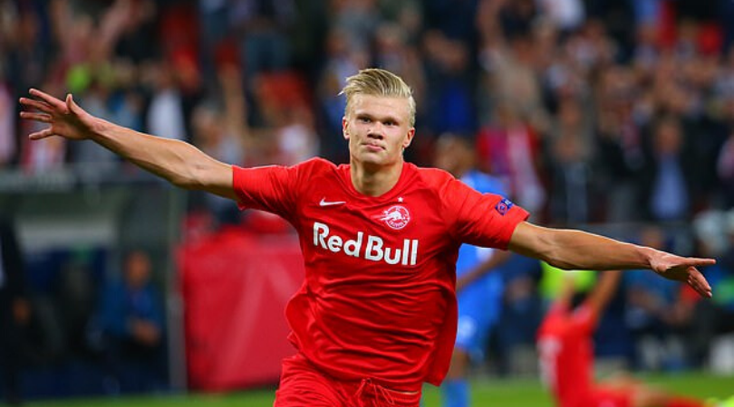 Erling Haaland spotted signing Manchester United Jersey amidst transfer speculations