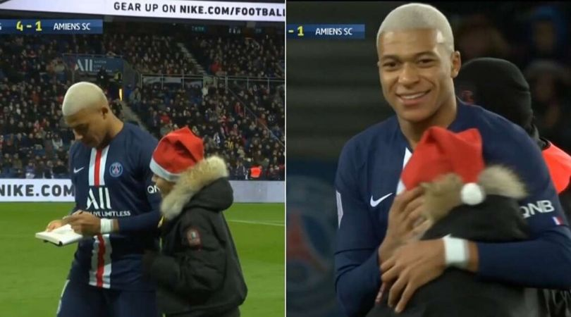 Kylian Mbappe signs an autograph for a young pitch invader in a beautiful moment during PSG vs Amiens