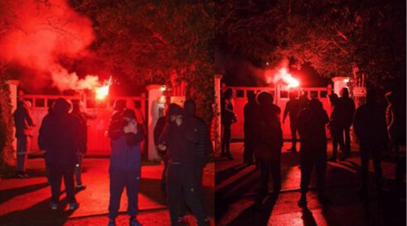Manchester United fans filmed throwing flares at Ed Woodward's house