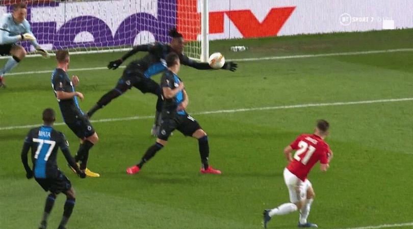 Simon Deli red card vs Man Utd Club Brugge defender sent off after hilarious handball and 5-minute long VAR check