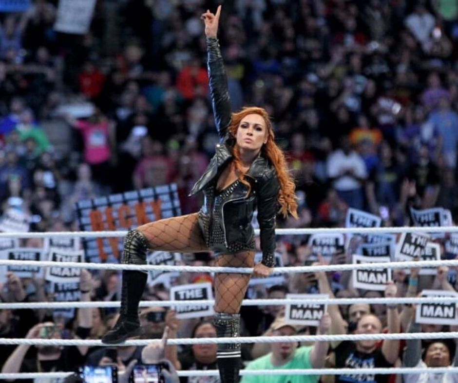 "Becky Lynch Reveals The Original ""Title Give In"" Plan"