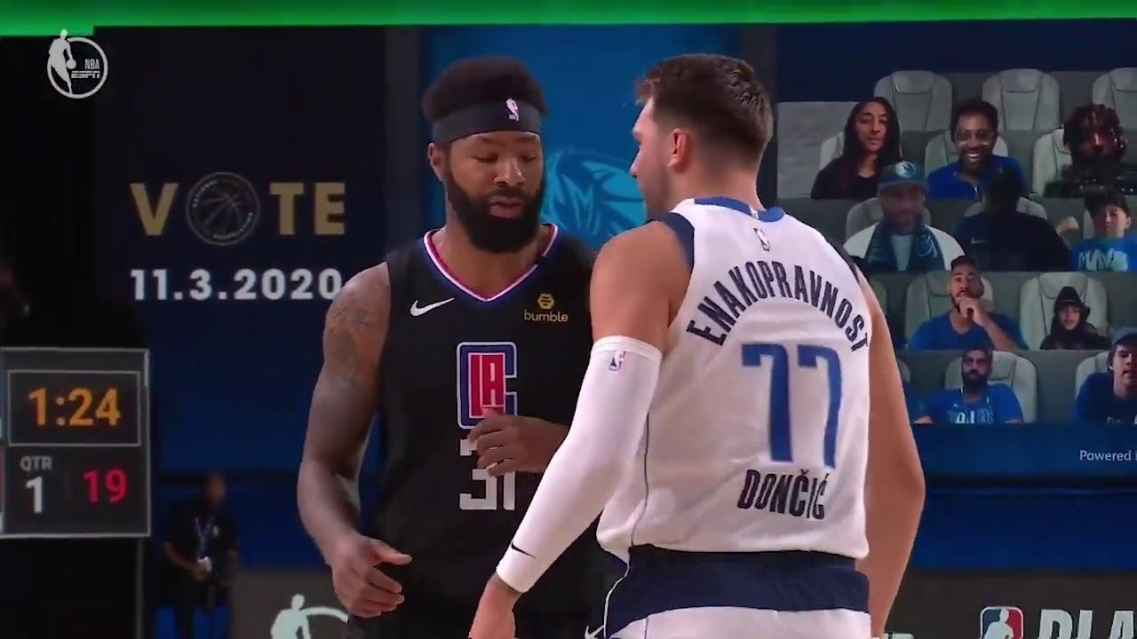 Marcus Morris slaps Luka Doncic on the head