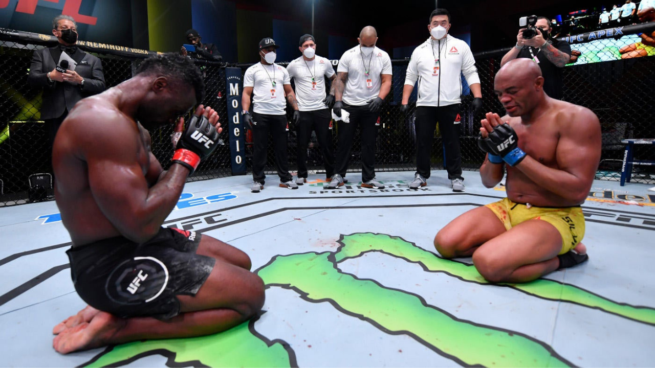 Uriah Hall cries in front of Anderson Silva after his TKO win at UFC Vegas 12
