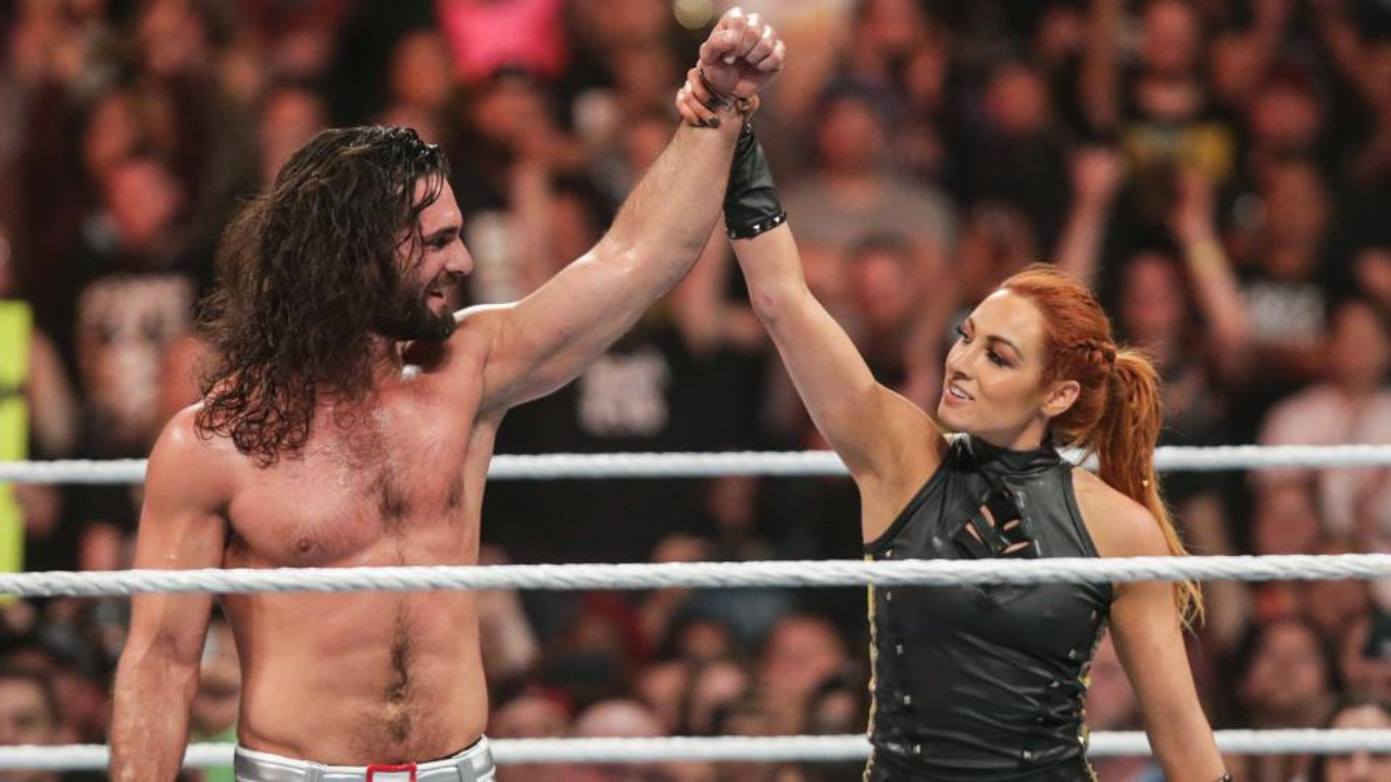 Becky Lynch and Seth Rollins introduce the world to their firstborn