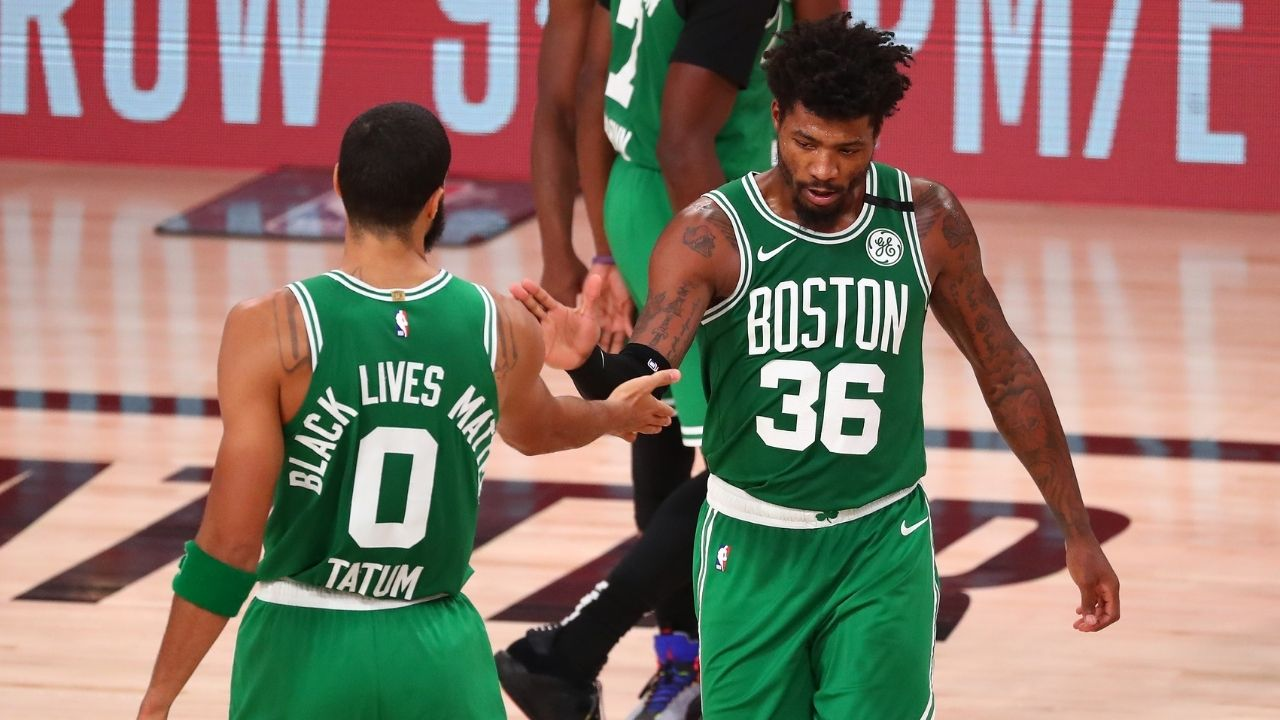 'Celtics locker room in turmoil': Marcus Smart gets his aged whiskey stolen and replaced by karaoke set during team's Secret Santa