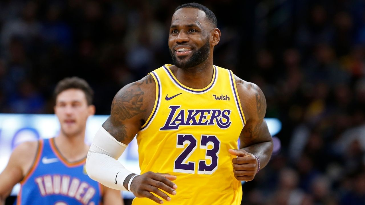 """""""LeBron James is just messing around"""": Lakers star hilariously tries tightrope walking on scorer's table during beatdown of Chicago Bulls"""