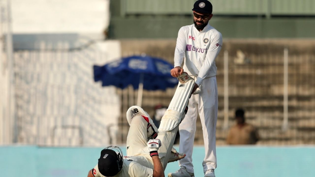 Spirit of Cricket: Virat Kohli stretches Joe Root's leg as the latter struggles with cramps in Chennai Test
