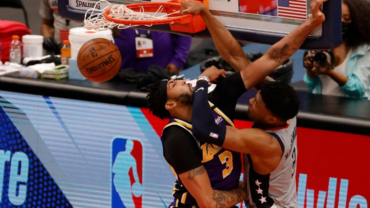 """""""LeBron James watched Anthony Davis get baptized"""": NBA Fans react to Rui Hachimura's wicked poster dunk over the Lakers superstar"""