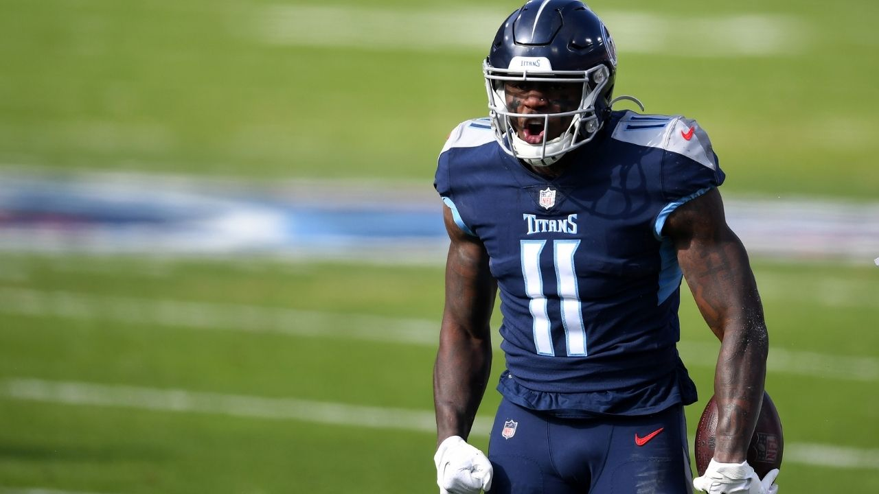"""Should I go back to that uno?"": Titans WR AJ Brown Reacts to proposed NFL jersey number rule change."