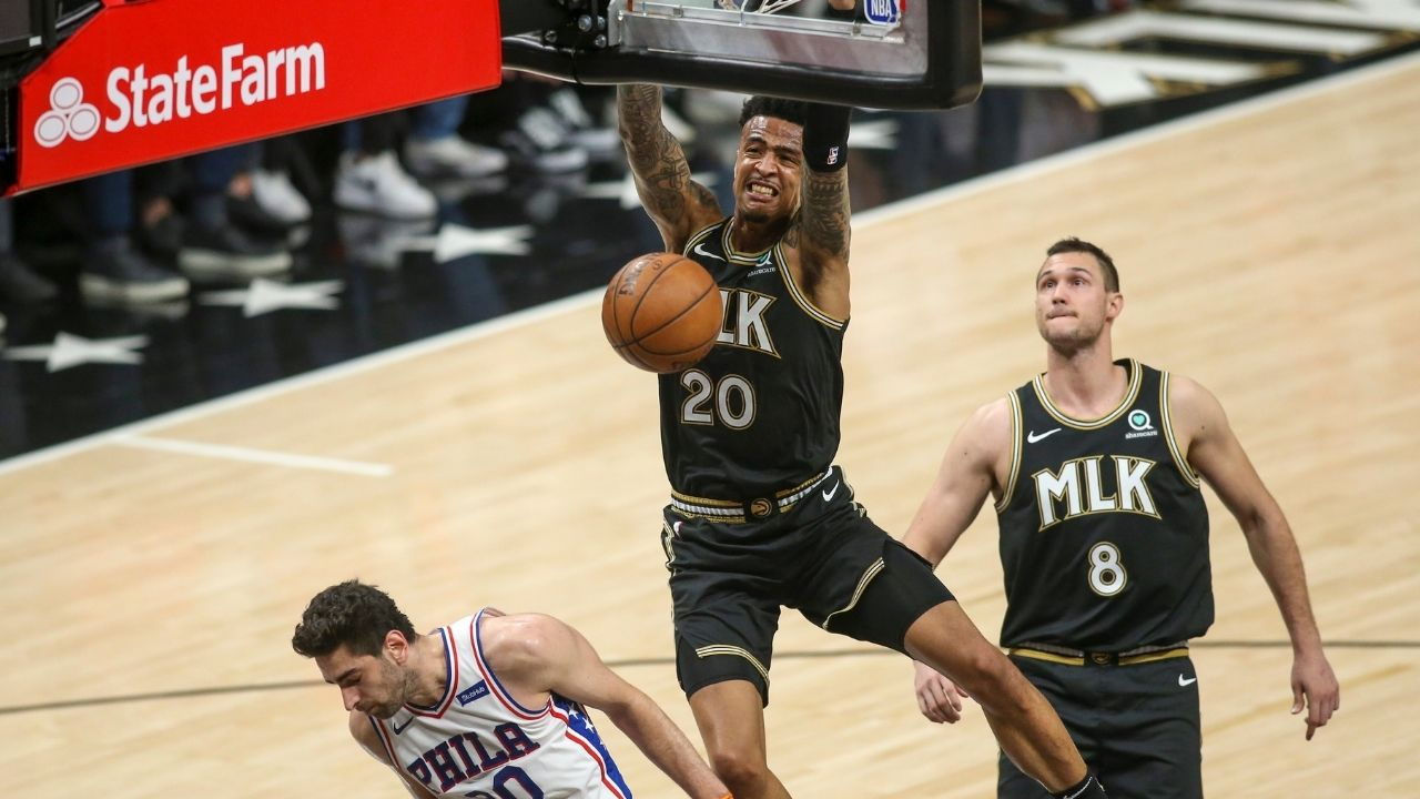 """""""John Collins put Joel Embiid in a choke hold and dunked on him!"""": NBA fans react to the Hawks big man's emphatic lob dunk from Trae Young over the Sixers MVP in Game 6"""