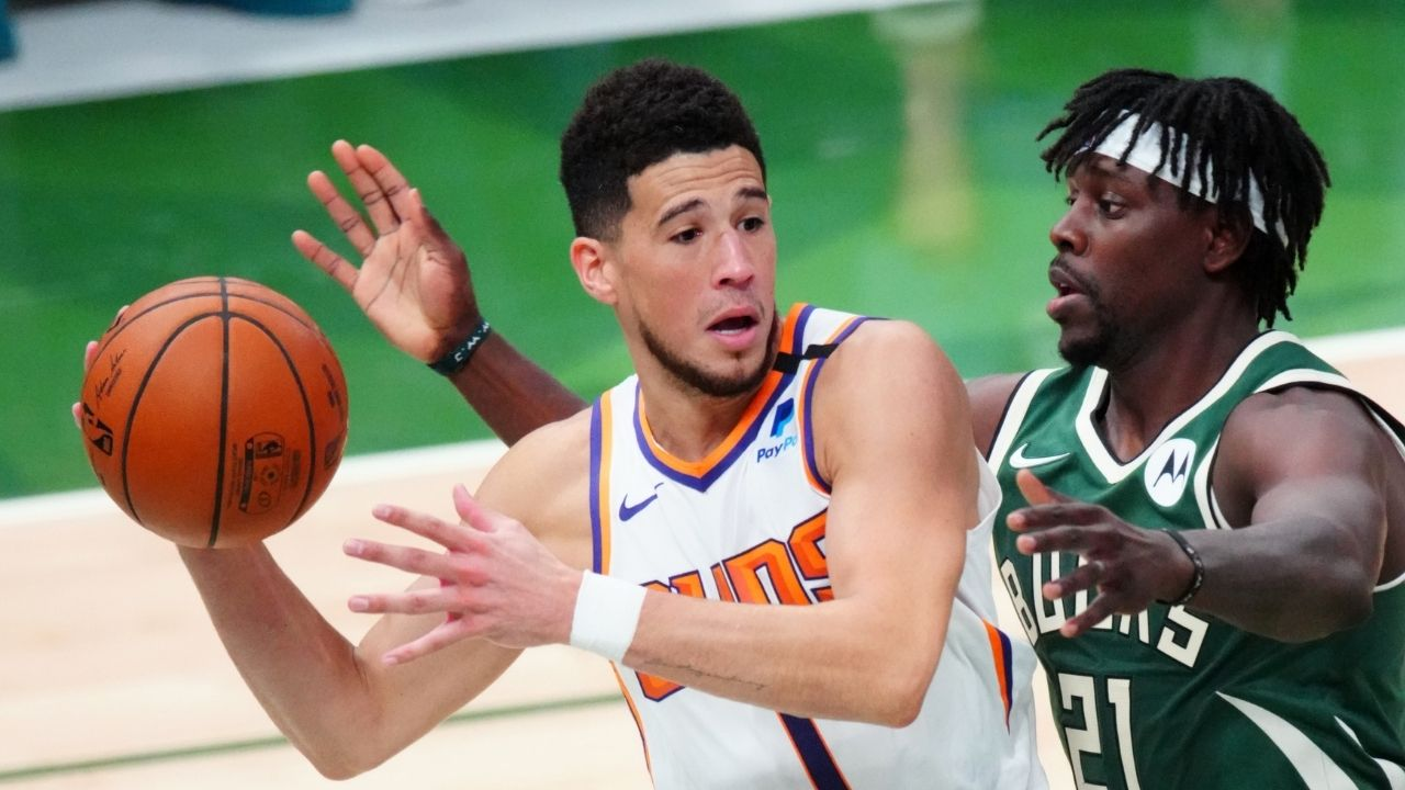 """""""Devin Booker literally wrapped his arms around Jrue Holiday"""": NBA fans react to the Suns superstar getting away with his 6th foul as the refs swallow their whistle in Bucks Game 4 win"""