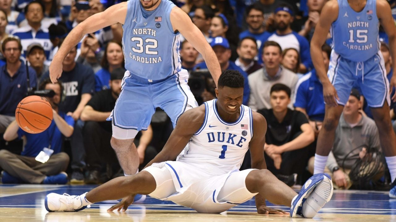 """""""Zion Williamson bursting his shoes was more memorable than Kyrie Irving's stint with Duke"""": When the Pelicans star's shoes tore during the Blue Devils-UNC matchup leading to an unfortunate knee injury"""