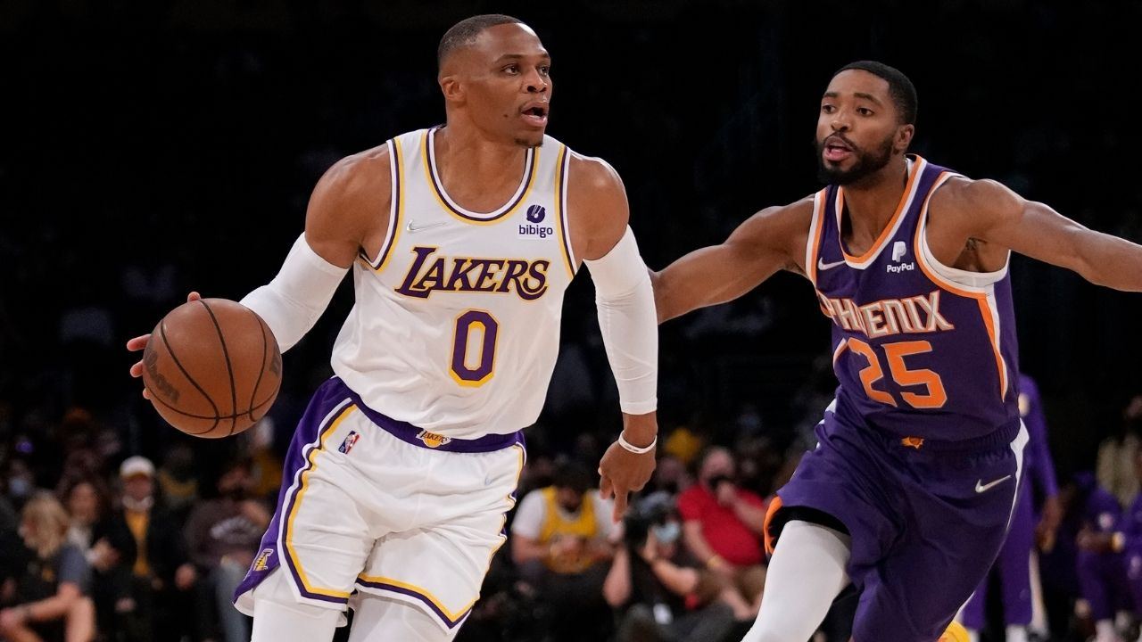 """""""Russell Westbrook out here slapping grown men!"""": Lakers fans react as 2017 MVP hilariously tries to slap somebody's hands away while giving a young fan his shoes"""
